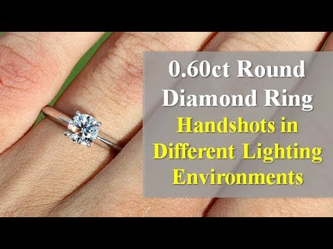 How a k color 0.60ct vs1 ideal cut solitaire diamond ring looks like when worn on a hand