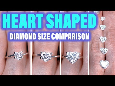 Heart shaped diamond ring size comparison on the hand finger. 1 carat engagement cut 2 ct 5 1/3 .75
