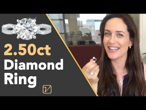 2.50 carat diamond ring   what a pave solitaire 2.50 carat engagement ring looks like on a finger